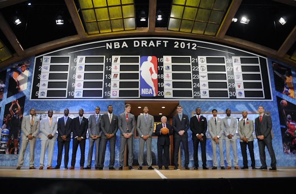 NBA Commissioner David Stern, center, holds a ball as he stands with members of the NBA basketball draft onstage before the draft on Thursday, June, 28, 2012, in Newark, N.J. (AP Photo/Bill Kostroun)