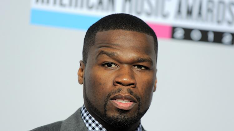 50 Cent, born Curtis Jackson, arrives at the 40th Anniversary American Music Awards on Sunday, Nov. 18, 2012, in Los Angeles. (Photo by Jordan Strauss/Invision/AP)
