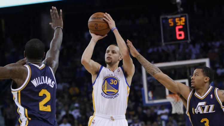 Curry, Thompson lead Warriors past Jazz 130-102