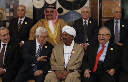 Palestinian President Abbas talks to Sudan's President Bashir during opening session of the 23rd Arab League summit in Baghdad