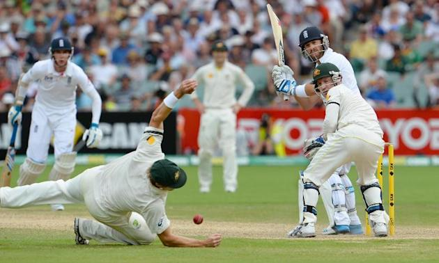 England batsman Matt Prior (R) looks around as Australian Shane Watson (L) drops the ball near wicketkeeper Brad Haddin during the fourth day of the second Ashes cricket Test match in Adelaide, on Dec