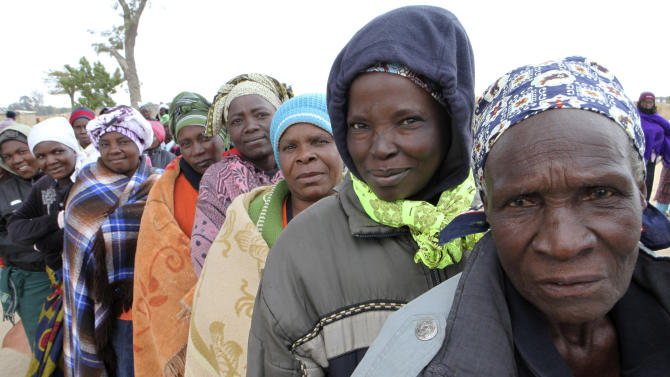 Zimbabweans wait to cast their votes in presidential and parliamentary elections in Harare, Wednesday, July 31, 2013. Zimbabweans voted Wednesday in the elections that will determine the future of longtime President Robert Mugabe, who has denied allegations of vote-rigging despite concerns about the credibility of the polls. (AP Photo/Tsvangirayi Mukwazhi)