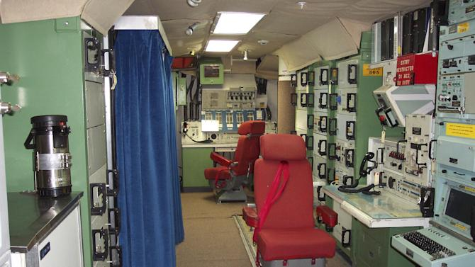 "FILE - This file photo provided by the National Park Service shows the inside of the deactivated Delta Nine Launch Facility near Wall, S.D., that is now open to the public. The Air Force stripped an unprecedented 17 officers of their authority to control _ and if necessary launch _ nuclear missiles after a string of unpublicized and unacceptable failings, including a potential compromise of missile launch codes. The group's deputy commander said it is suffering ""rot"" within its ranks. The tip-off to trouble was a March 2013 inspection of the 91st Missile Wing at Minot Air Force Base, N.D., which earned the equivalent of a ""D"" grade when tested on its mastery of Minuteman III missile launch operations.  (AP Photo/National Park Service, File)"
