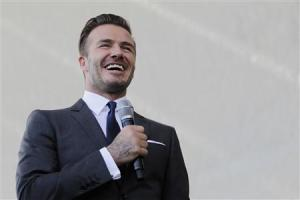 David Beckham laughs as he discusses matters related to the ownership position he has with a proposed MLS expansion team that could play in Miami, at a news conference in Miami