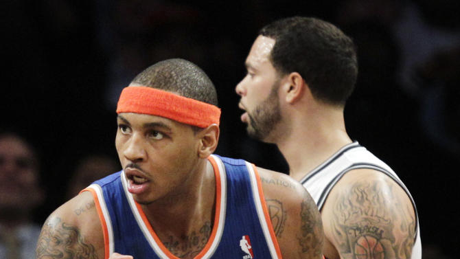 New York Knicks forward Carmelo Anthony (7) reacts after hitting a shot ahead of Brooklyn Nets guard Deron Williams (8) during the second half of their NBA basketball game at Barclays Center, Tuesday, Dec. 11, 2012, in New York. The Knicks won 100-97. (AP Photo/Kathy Willens)