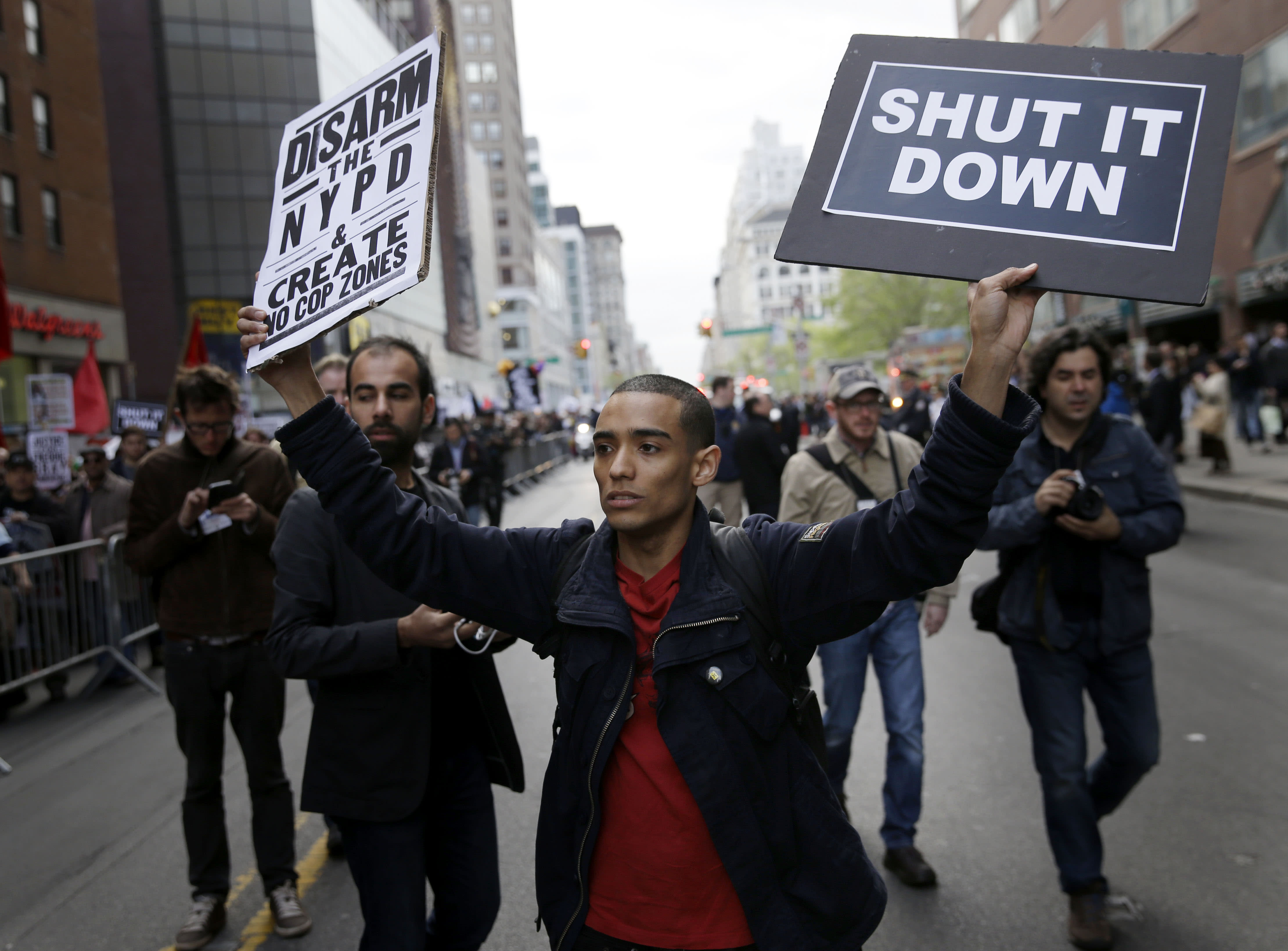Latest on Baltimore protests: Thousands march across US
