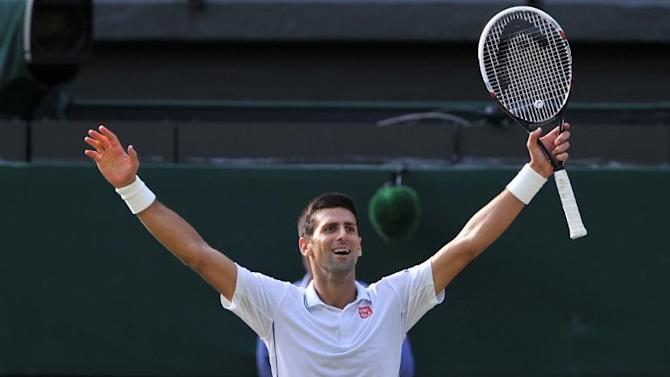 Serbia's Novak Djokovic celebrates winning his men's singles final match against Switzerland's Roger Federer on day thirteen of the 2014 Wimbledon Championships at The All England Tennis Club in Wimbledon, southwest London, on July 6, 2014
