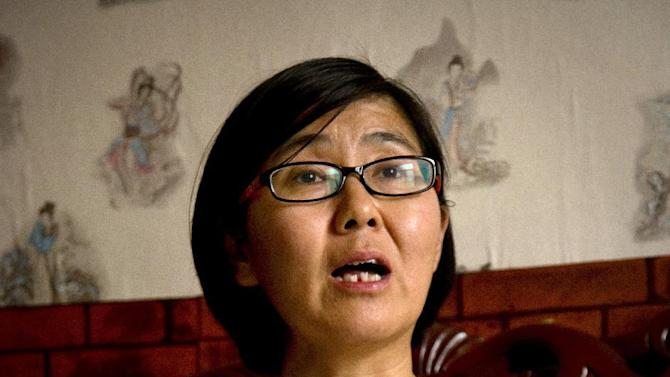 In this April 18, 2015 photo, Wang Yu, a lawyer for Chinese activist Li Tingting, speaks during an interview in Beijing. Li, one of five recently released female Chinese feminists feels her dedication to activism has grown only stronger after spending 37 days in detention with interrogators who blew smoke onto her face and insulted her sexual orientation, her girlfriend and her lawyer said. (AP Photo/Mark Schiefelbein)
