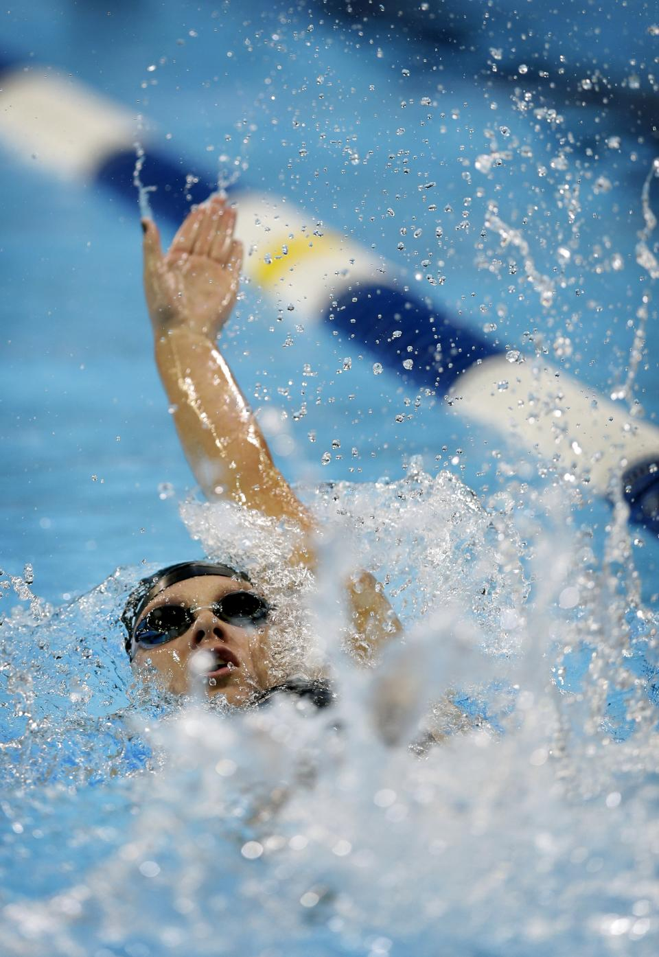 Ella Eastin swims in the women's 100-meter backstroke preliminaries at the U.S. Olympic swimming trials, Tuesday, June 26, 2012, in Omaha, Neb. (AP Photo/David J. Phillip)
