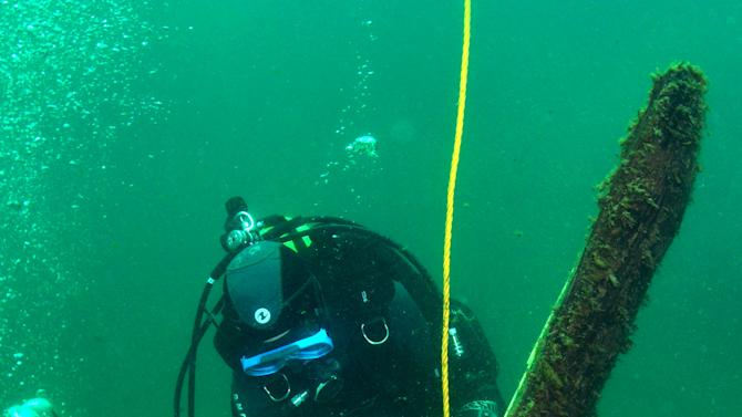 In this Saturday, June 15, 2013 file photo provided by Great Lakes Exploration Group,  French underwater archaeologist Olivia Hulot jots notes while inspecting a timber jutting from the bottom of northern Lake Michigan that experts believe could be part of the long-lost ship the Griffin. A wooden beam that has long been the focus of the search for a 17th century shipwreck in northern Lake Michigan was not attached to a buried vessel as searchers had suspected, but still may have come from the elusive Griffin or some other ship, archaeologists said Wednesday, June 19, 2013 (AP Photo/Great Lakes Exploration Group, Chris Doyal, File)