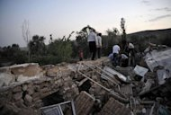Iranians search for survivors under the rubble of houses in the town of Varzaqan, some 60 kms northeast of Tabriz after twin earthquakes hit northwestern Iran