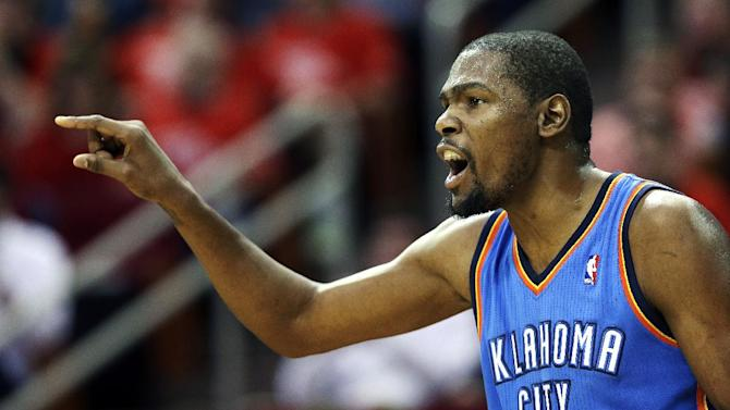 Oklahoma City Thunder's Kevin Durant yells to his teammates during the first quarter of Game 4 in their first-round NBA basketball playoff series against the Houston Rockets Monday, April 29, 2013, in Houston. (AP Photo/David J. Phillip)