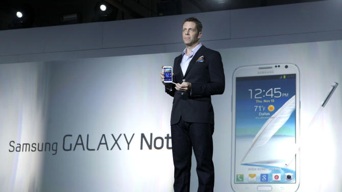 Kevin Packingham, chief product officer for Samsung Mobile USA, demonstrates the new Samsung Galaxy Note II during a launch event, Wednesday, Oct. 24, 2012, in New York. Aside from the 5.5 inch screen, the Note comes with a stylus and runs the latest version of Google's Android operating system, Jelly Bean. (AP Photo/Jason DeCrow)
