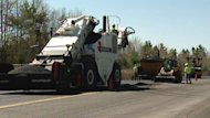 The province's decision to purchase a mobile paving plant for $3.5 million continues to draw criticism.