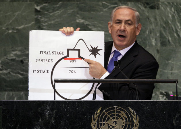 "FILE - In this Sept. 27, 2012 file photo, Israeli Prime Minister Benjamin Netanyahu shows an illustration as he describes his concerns over Iran's nuclear ambitions during his address to the 67th session of the United Nations General Assembly at U.N. headquarters. Iran is considering a more confrontational strategy at possible renewed nuclear talks with world powers, threatening to boost levels of uranium enrichment unless the West makes clear concessions to ease sanctions. Such a gambit outlined by senior Iranian officials in interviews could push Iran's atomic program far closer to Israel's ""red line."" (AP Photo/Richard Drew, File)"