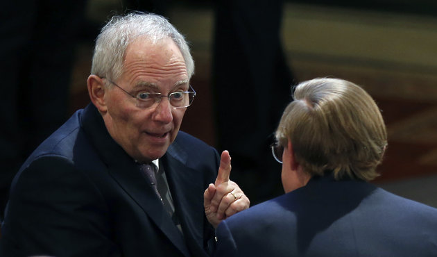 German Finance Minister Wolfgang Schaeuble, left, talks to Robert Zoellick, former President of the World Bank, prior to the start of the Security Conference in Munich, southern Germany, on Friday, Feb. 1, 2013. The 49th Munich Security Conference starts Friday afternoon with experts from 90 delegations including US Vice President Joe Biden. (AP Photo/Matthias Schrader)