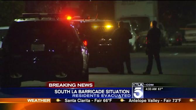 Man Barricaded Inside South L.A. Home , Prompting SWAT Standoff; Dozens Evacuated