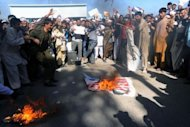 Afghan demonstrators torch a US flag during an anti-US protest in Herat. Demonstrators poured into the streets of Herat shouting anti-US slogans to protest against a film mocking Islam that has sparked deadly riots in the Middle East and North Africa