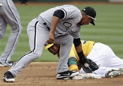 A's score 3 in 14th, rally past White Sox 5-4