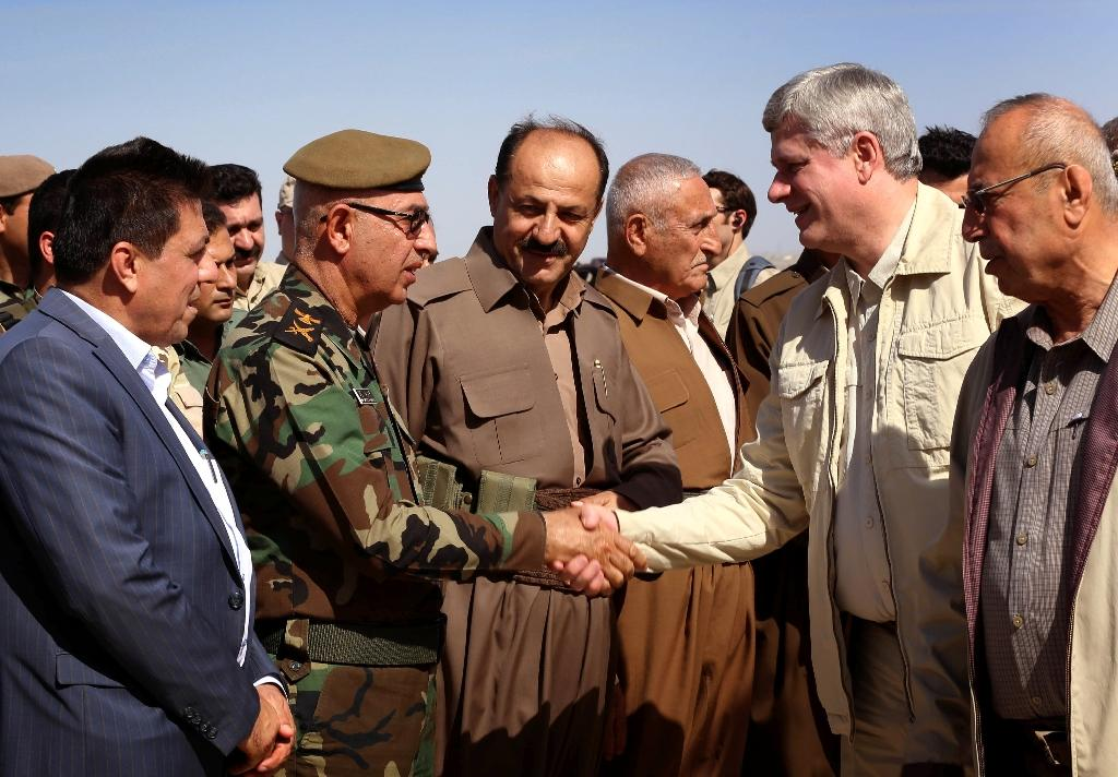 Canada PM visits Iraq after air war extension
