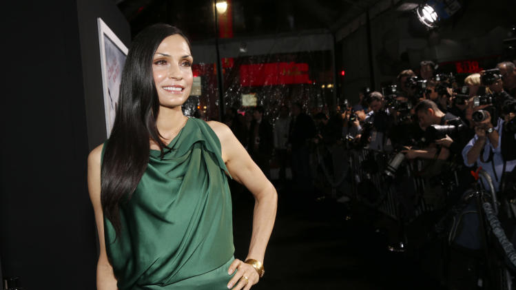 "Famke Janssen arrives at the premiere of ""Hansel & Gretel Witch Hunters"" on Thursday Jan. 24, 2013, in Los Angeles.  (Photo by Todd Williamson/Invision/AP)"