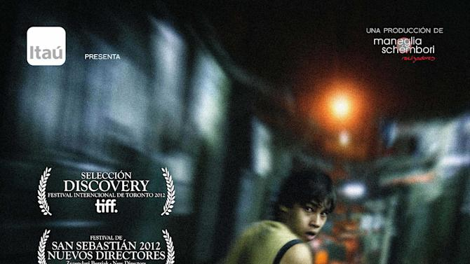 """In this photo released by """"7 Cajas,"""" Paraguayan actor Celso Franco, 23, is seen in a poster of Paragauay's movie """"7 Cajas"""", """"7 Boxes"""" in Spanish, by directors Juan Carlos Maneglia and Tana Schembori. A new action movie featuring a poor delivery boy whose life depends on the mysterious cargo in his wheelbarrow has Paraguayans excited and proud to see their gritty reality on the big screen for the first time. (AP Photo/7 Cajas, Richard Careaga)"""