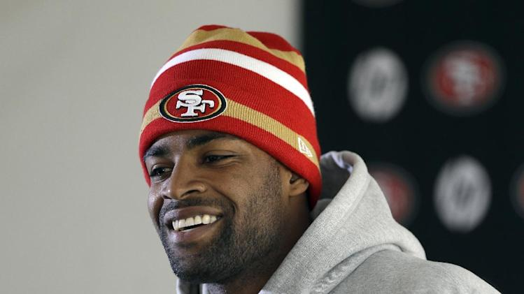 49ers Michael Crabtree smiles during a media conference before an NFL