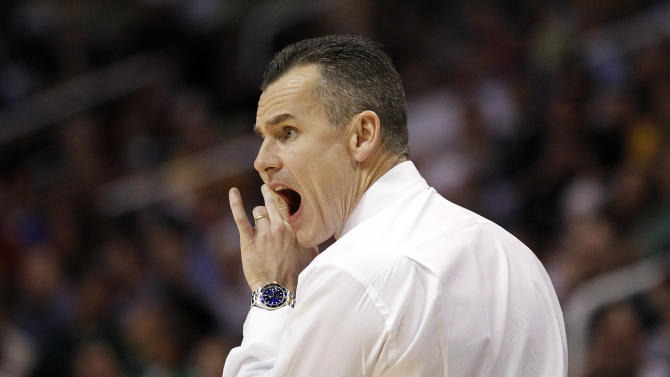 Florida coach Billy Donovan calls out to his team as it plays Marquette during the first half of an NCAA men's college basketball tournament West Regional semifinal on Thursday, March 22, 2012, in Phoenix. (AP Photo/Chris Carlson)