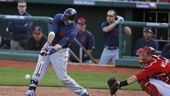Cleveland Indians' Lonnie Chisenhall hits during the second inning of a spring training exhibition baseball game against the Cincinnati Reds, Tuesday, March 3, 2015, in Goodyear, Ariz. He was tagged out at first on the play. (AP Photo/John Locher)