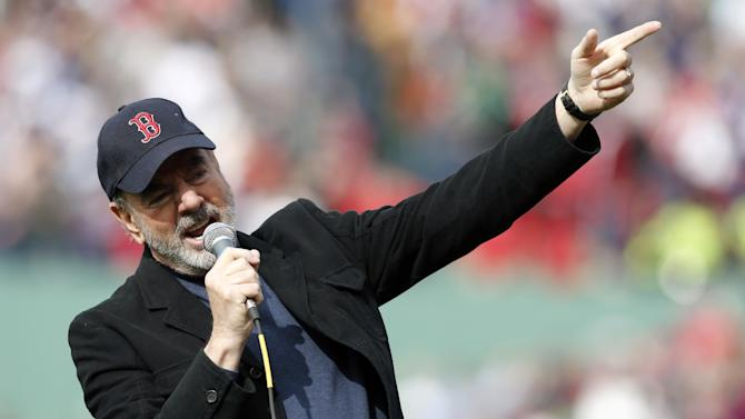 """Neil Diamond sings '""""Sweet Caroline"""" during the eighth inning of a baseball game between the Boston Red Sox and the Kansas City Royals in Boston, Saturday, April 20, 2013. (AP Photo/Michael Dwyer)"""