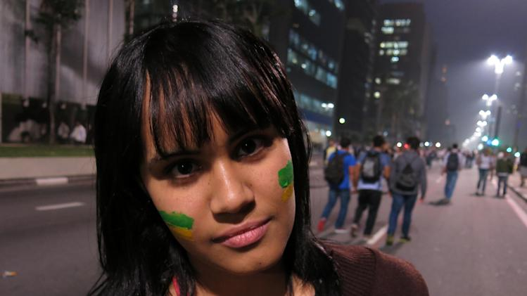 """Erika Ribeira poses for a photo at an anti-government protest in Sao Paulo, Brazil, Thursday, June 20, 2013. The 17-year-old student says, """"We must invest in education before we invest so much money in the World Cup. We need schools, not stadiums."""" (AP Photo/Bradley Brooks)"""