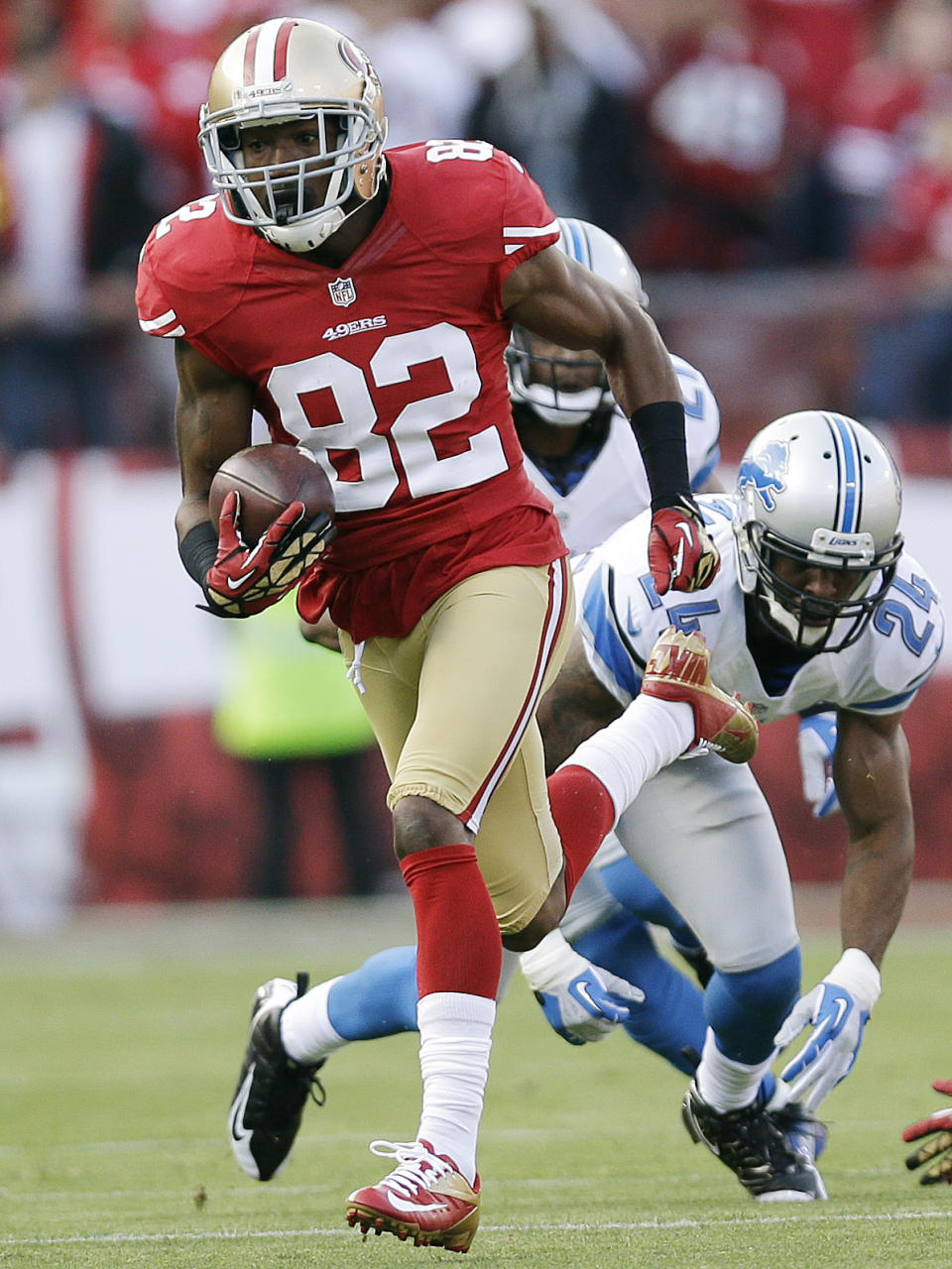 San Francisco 49ers wide receiver Mario Manningham carries the ball past Detroit Lions strong safety Erik Coleman, right, during the first quarter of an NFL football game in San Francisco, Sunday, Sept. 16, 2012. (AP Photo/Marcio Jose Sanchez)