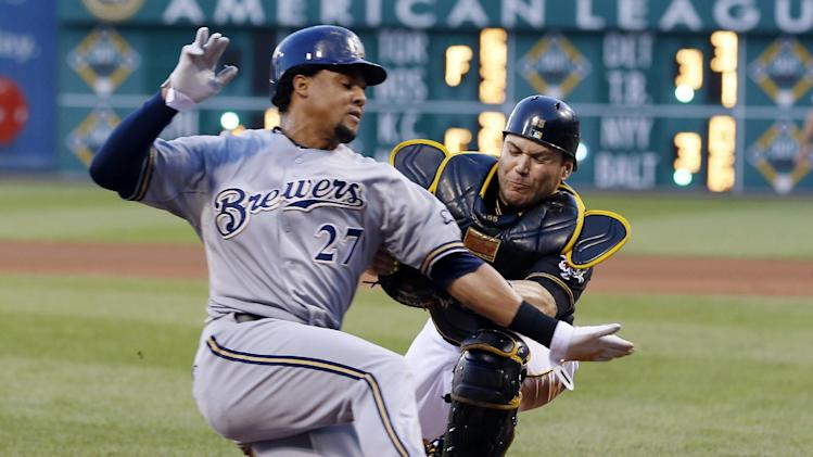Pittsburgh Pirates catcher Russell Martin, right, tags Milwaukee Brewers' Carlos Gomez out at home plate as he tried to score from third on a ground ball by Jonathan Lucroy in the fourth inning of the baseball game on Saturday, June 29, 2013, in Pittsburgh. Lucroy was safe at first. (AP Photo/Keith Srakocic)