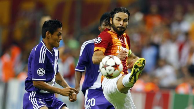 Inan of Galatasaray fights for the ball with Najar of Anderlecht during their Champions League Group D soccer match in Istanbul