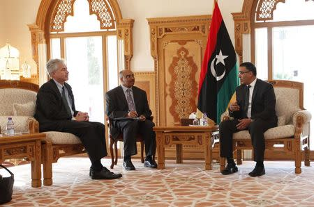 First Deputy President of Libya's General National Congress Ezzedine Muhammad Yunus al-Awami meets with U.S. Deputy Secretary of State William Burns at the headquarters of the National General Congress in Tripoli