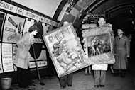 People carry paintings in the London Underground as a cleaning woman looks on in 1946. The London Underground began celebrating its 150th birthday on Wednesday, creaking under the demand of four million daily passengers as it looked back to the opening of the world&#39;s first underground railway in 1863