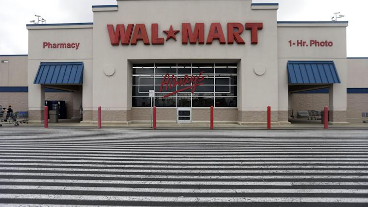 FILE - This July 12, 2013, file photo, shows a Wal-Mart, in Bristol, Pa. Wal-Mart Stores Inc. reports quarterly financial results on Thursday, Nov. 14, 2013. (AP Photo/Matt Rourke, File)