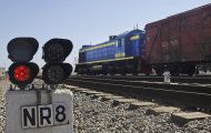 "In this Tuesday, March 6, 2012 photo, a cargo train is seen at the train station in Mazar-i-Sharif, Balkh province north of Kabul, Afghanistan. Afghanistan has just opened its first major railroad and is planning a half dozen more. The government is also inviting other countries to build tracks, part of plans for a ""New Silk Route"" that the U.S. hopes will help stabilize the region by promoting trading links. ( AP Photo/Mustafa Najafizada)"