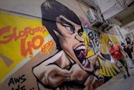 Graffiti depicting the late martial arts icon Bruce Lee, seen in Hong Kong, on July 16, 2013. Hong Kong marks Lee's 40th anniversary on July 20