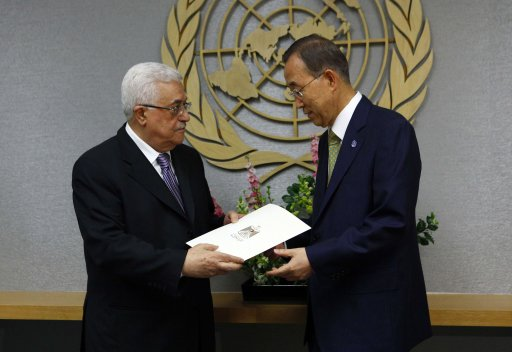 Palestinian Authority president Mahmoud Abbas hands a letter to United Nations Secretary General Ban Ki-Moon requesting Palestinian statehood at the 66th United Nations General Assembly at U.N. headquarters in New York