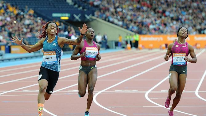 Michelle-Lee Ahye, left, celebrates winning the women's 100m on day two of the Diamond League Meeting at Hampden Park, Glasgow, Saturday July 12, 2014. (AP Photo/PA, Martin Rickett) UNITED KINGDOM OUT NO SALES NO ARCHIVE