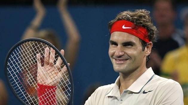 Roger Federer of Switzerland acknowledges the crowd after defeating Jeremy Chardy of France in their men's singles semi-final match at the Brisbane International tennis tournament in Brisbane, January 4, 2014 (Reuters)
