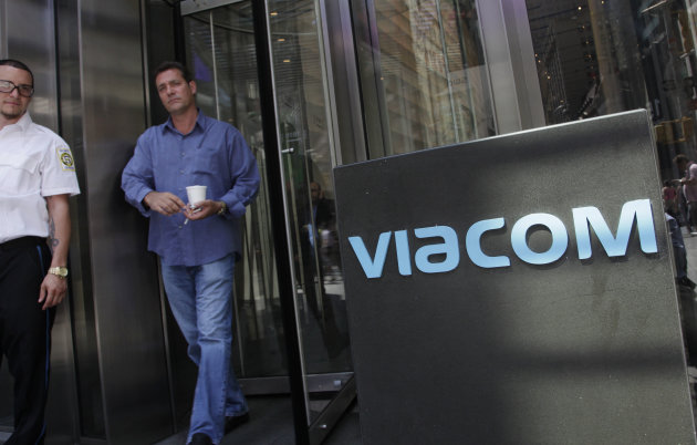 In this Aug. 3, 2011 photo, a man walks out of the Viacom headquarters, in New York. Viacom says, Friday, Aug. 3, 2012, its net income fell 7 percent in the latest quarter as advertising revenue declined more than expected, and its movie releases failed to measure up to last year&#39;s. (AP Photo/Mark Lennihan)
