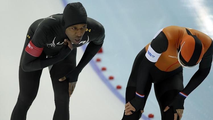 Shani Davis of the U.S., left, and Koen Verweij of the Netherlands rest after competing in the men's 1,000-meter speedskating race at the Adler Arena Skating Center during the 2014 Winter Olympics, in Sochi, Russia, Wednesday, Feb. 12, 2014