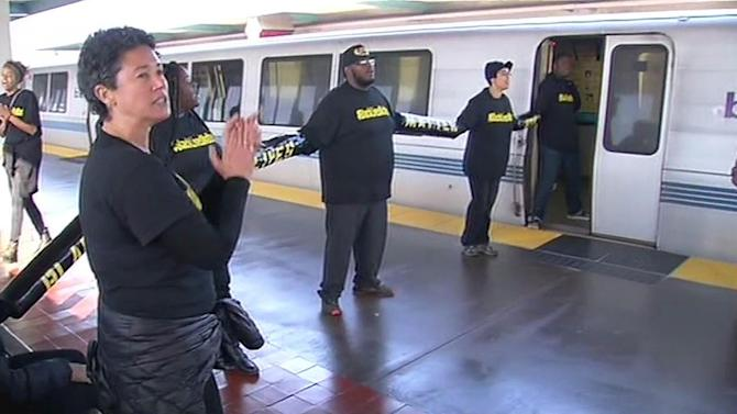 Police arrest protesters chained to BART trains in West Oakland