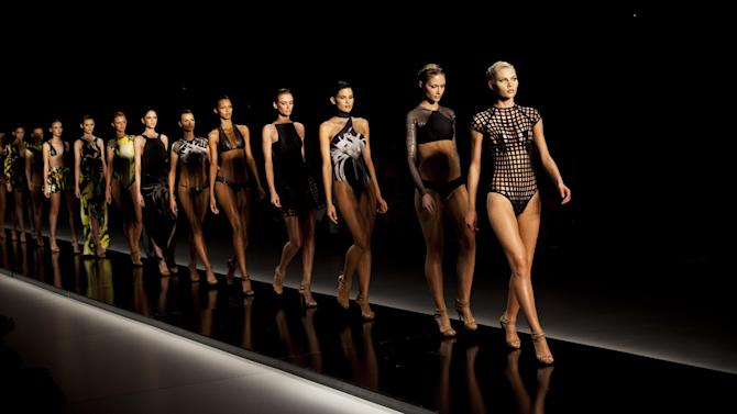Models parade on the catwalk in creations from the Lenny summer collection at Fashion Rio  in Rio de Janeiro, Brazil, Friday, May 25, 2012. (AP Photo/Victor R. Caivano)