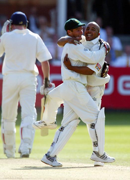 Paul Adams of South Africa (R) congratulates Mark Boucher
