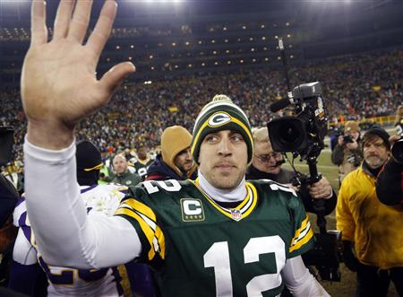 Green Bay Packers quarterback Aaron Rodgers (12) waves to fans after defeating the Minnesota Vikings in their NFL NFC wildcard playoff football game in Green Bay, Wisconsin January 5, 2013. REUTERS/Tom Lynn