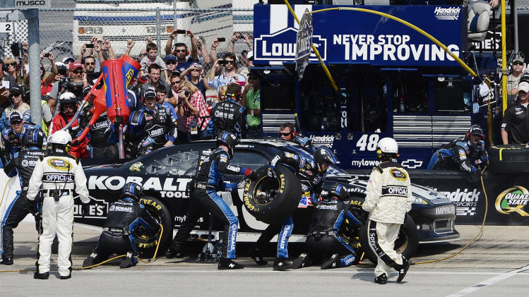 Jimmie Johnson makes a pit stop during the NASCAR Sprint Cup Series auto race at Chicagoland Speedway in Joliet, Ill., Sunday, Sept. 16, 2012. (AP Photo/Warren Stewart)
