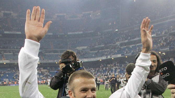 FILE- In Sunday, June 17, 2007 file photo, Real Madrid player David Beckham waves goodbye to his fans after the Spanish League soccer match against Mallorca in Madrid. David Beckham will join Paris Saint-Germain on Thursday, Jan. 31, 2013, opting for a move to France after mulling over lucrative offers from around the world since leaving the Los Angeles Galaxy. The 37-year-old Beckham was to undergo a medical examination in the French capital before being officially presented as PSG's latest recruit, a person familiar with the situation told The Associated Press. The person spoke on condition of anonymity because the deal has not yet been completed. (AP Photo/Fernando Bustamante, File)